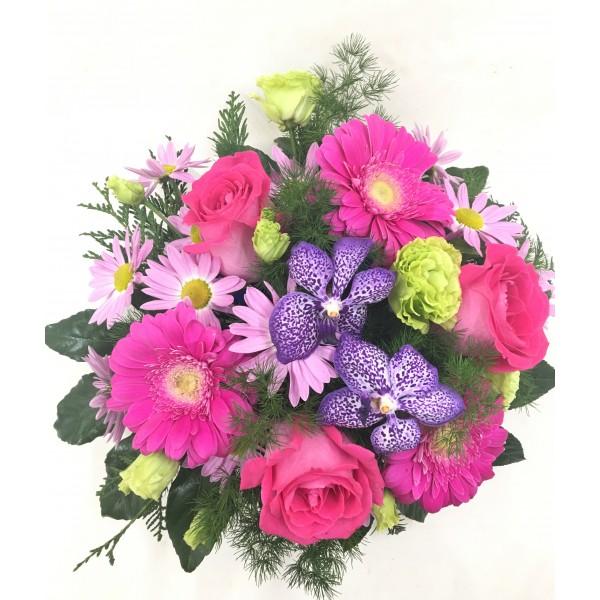 Centro redondo flores variadas tonos rosáceos